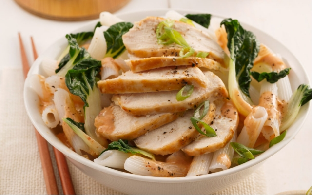 Rice noodles and chicken with lime and baby bok choy