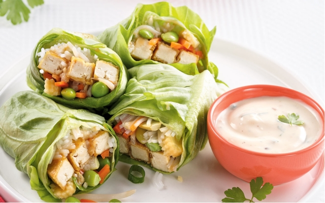 Asian rolls on lettuce leaves